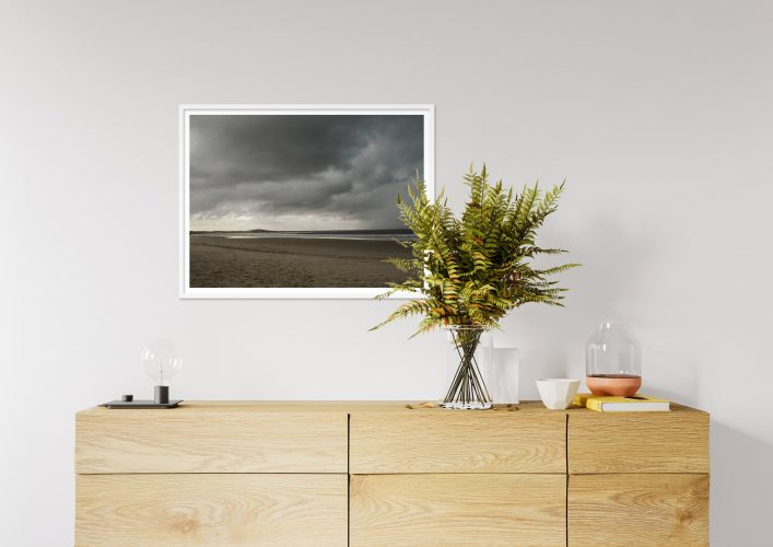 Art Print of Beach Landscape hanging on the living room wall